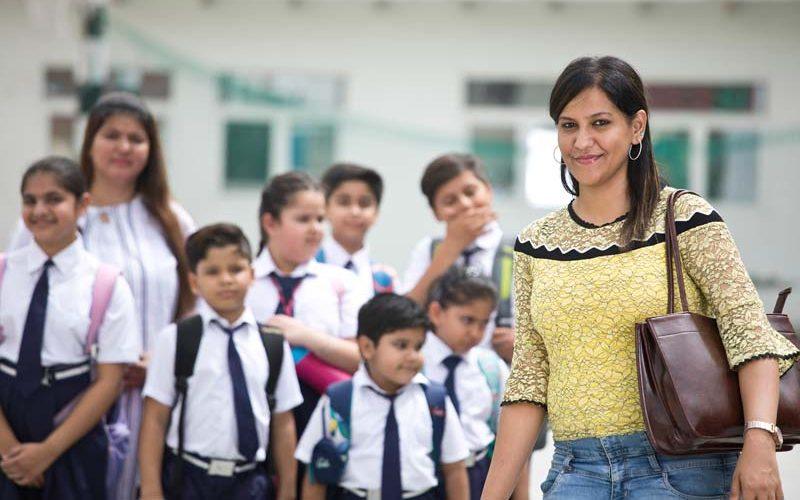 K-12 School Teacher with Her Students